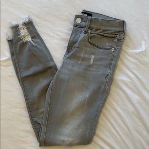 Express Jeans. slightly distressed. grey denim.